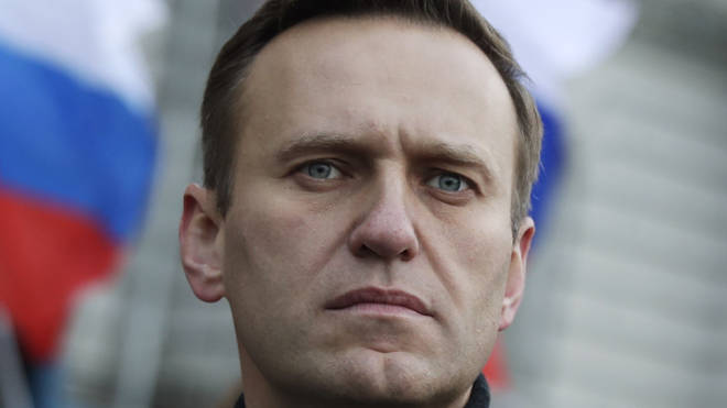 Alexei Navalny's supporters believe he was given poisoned tea on a plane