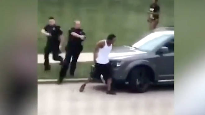 The video appeared to show police officers shooting at a man's back seven times