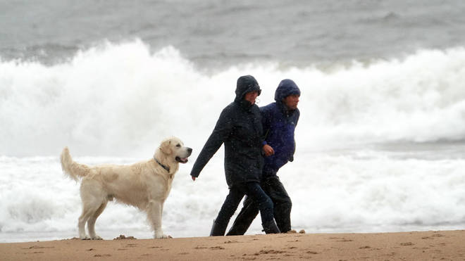 Walkers on a windy Tynemouth beach as Storm Francis has brought gusts of more than 50mph overnight ahead of the wet and windy weather impacting vast swathes of the UK and Ireland.