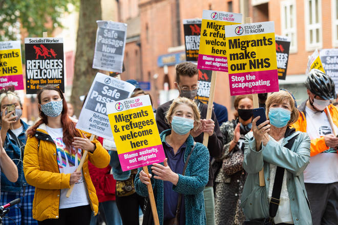 Pro-migrant demonstrators have marched on the Home Office