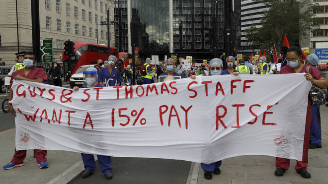 Workers, who have hinted at strike action, made their way to Whitehall on Wednesday