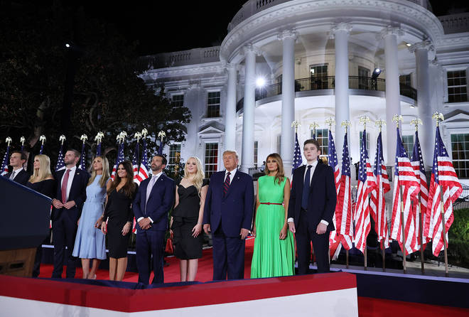 US President Donald Trump (3R) and first lady Melania Trump (2R) stand with their family members following his acceptance speech for the Republican presidential nomination