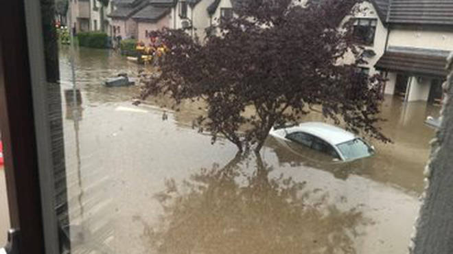 Severe flooding was left cars partially submerged in water