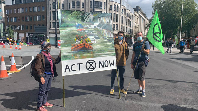 Protesters in Cardiff carried placards calling for action against climate change