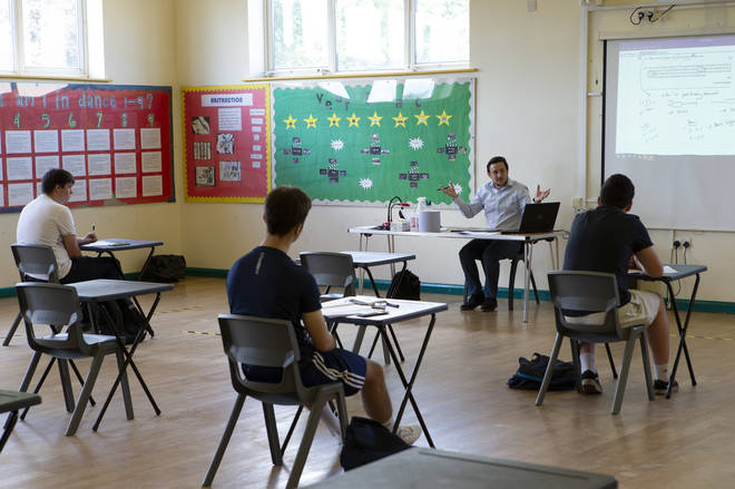 A teacher at the front of a class of Year 12 pupils. Ortu Gable Hall School in Corringham