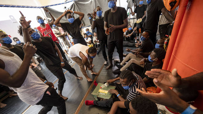 Migrants from eastern Africa dance onboard the Sea-Watch 4 civil sea rescue ship