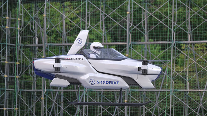 A test flight of a manned 'flying car'