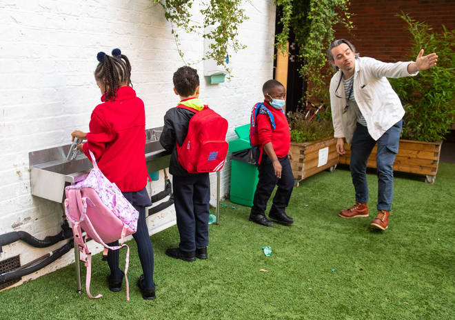 Pupils wash their hands as they arrive on the first day back to school at Charles Dickens Primary School in London, as schools in England reopen to pupils following the coronavirus lockdown.