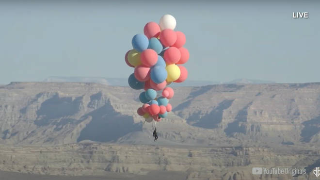 Is it a bird? Is it a plane? No it's David Blaine holding onto 52 helium balloons