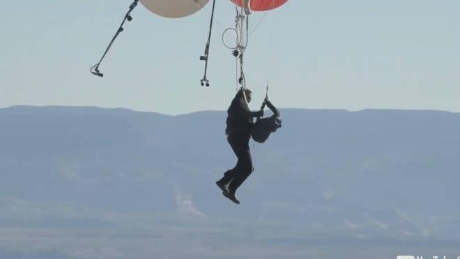 David Blaine attaching himself to his parachute mid-flight