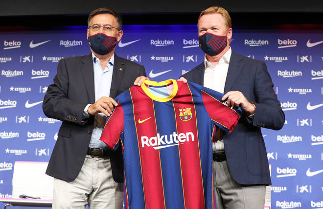 New manager Koeman (R) poses with president Bartomeu (L) whose running of the club Messi is unhappy with