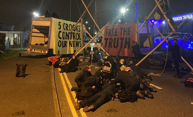 Extinction Rebellion protesters have blockaded a printworks in Liverpool