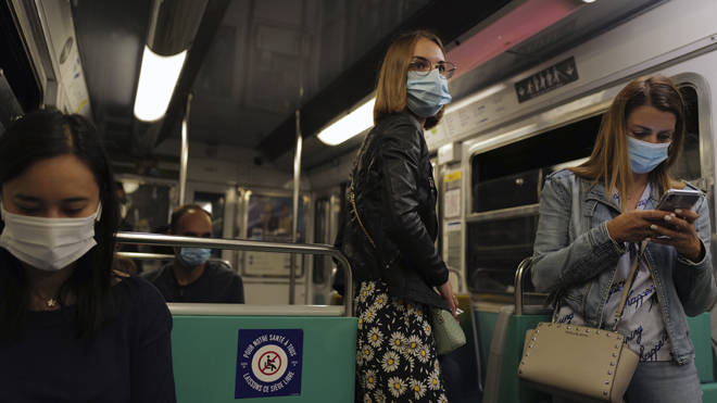 Women wear masks on the Paris metro