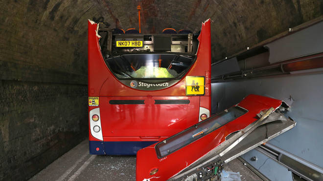 The roof of the bus was torn off as it crashed into the railway bridge