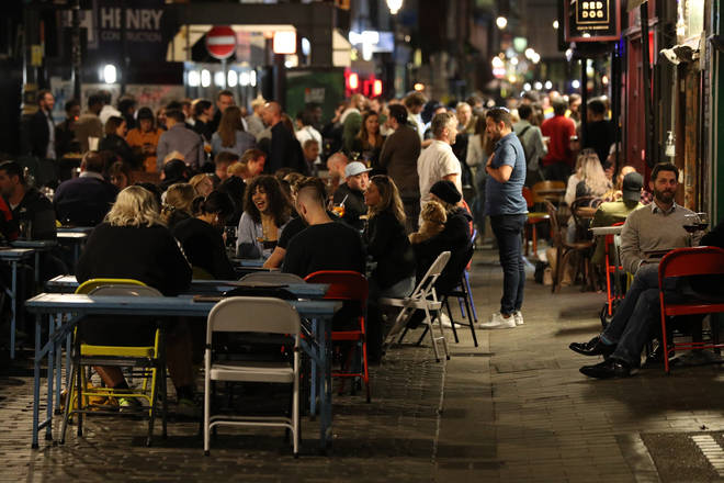 File photo: Groups of people gather in Soho, London