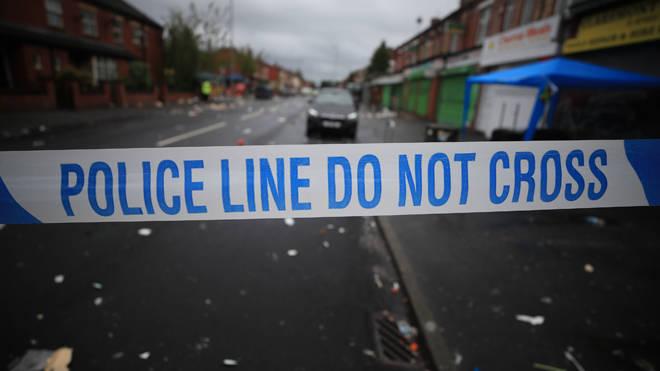 A woman was shot in a street in west London last night