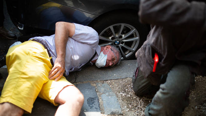 A protester on the ground after fighting with another demonstrator