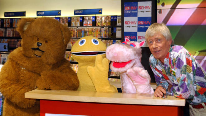 Bungle, Zippy, George, and presenter Geoffrey Hayes on television show Rainbow