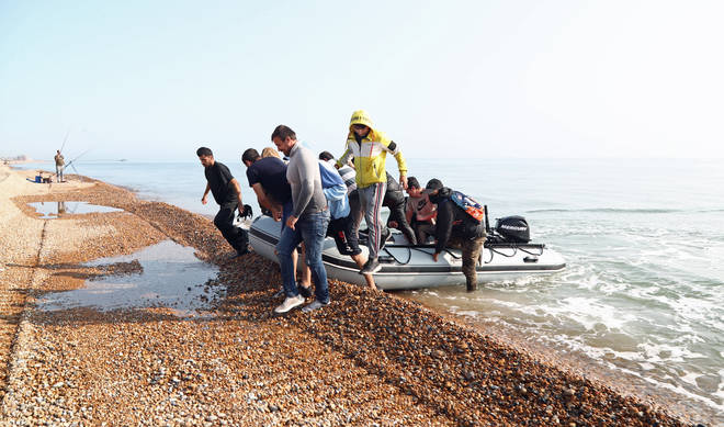 The group of men, believed to be migrants, arriving in the UK
