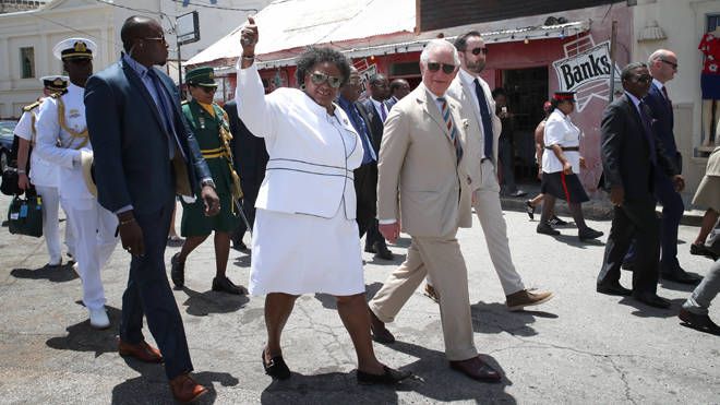 The Prince of Wales during a walkabout with the Prime Minister of Barbados Ms Mia Mottley last year
