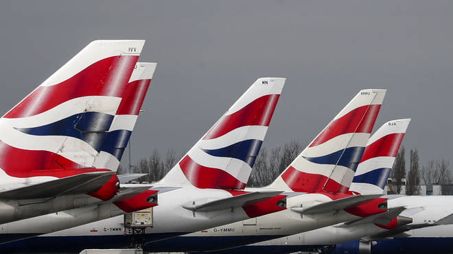The boss of British Airways has defended the airline's decision to cut up to 12,000 jobs