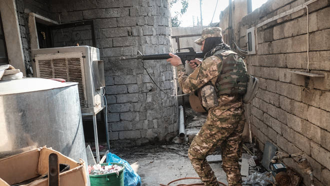 An Iraqi Army soldier searches for ISIS fighters