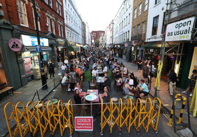 People drinking and dining out in Soho, London