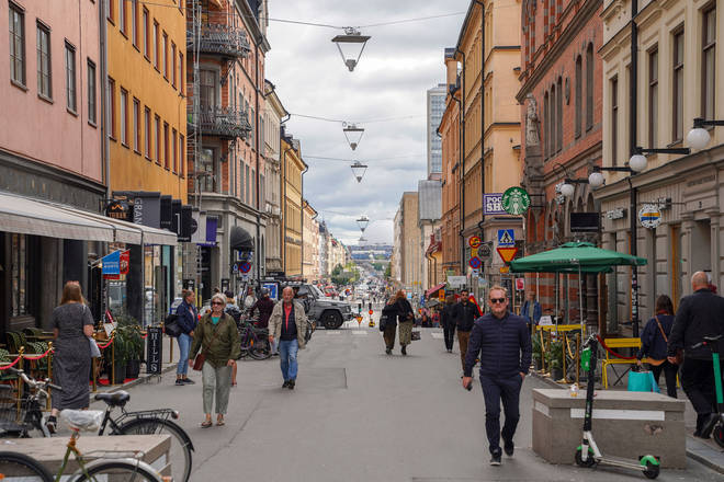 File photo: People walking in a street in Stockholm