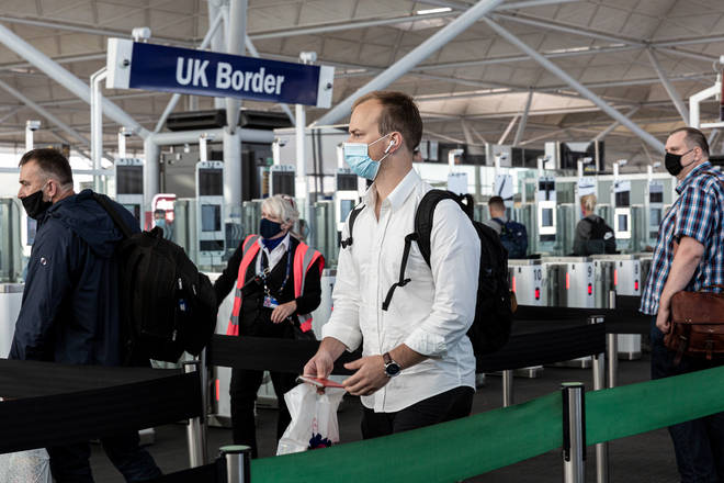 Scientific advisers have warned about outbreaks caused by coronavirus being brought into the UK from abroad
