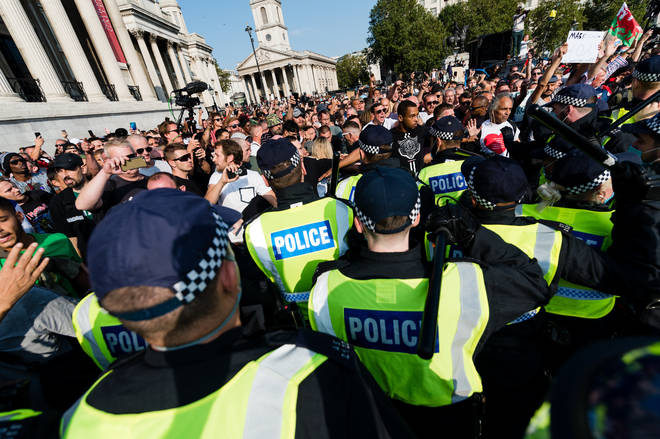 Police made 32 arrests as violent scuffles broke out