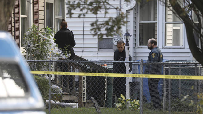 Investigators behind police tape at the scene of a shooting in New York state