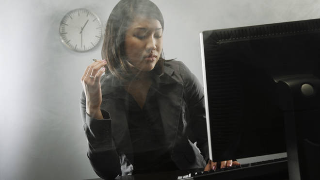 Workers were effectively banned from smoking in their home offices (file image)