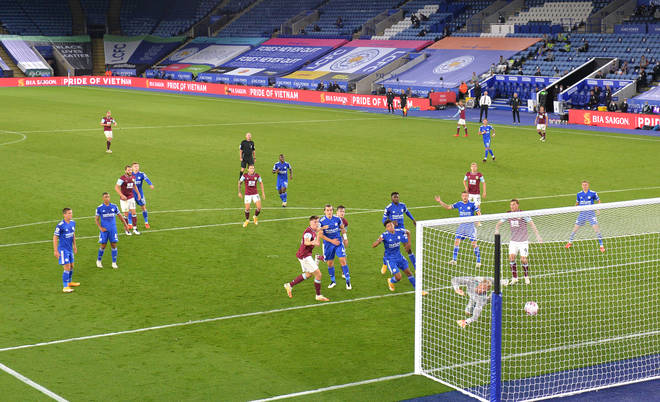 Burnley's Jimmy Dunne (centre left) scores his side's second goal of the game during the Premier League match at the King Power Stadium