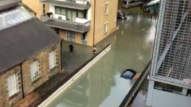 Flood in Hackney leaves cars submerged