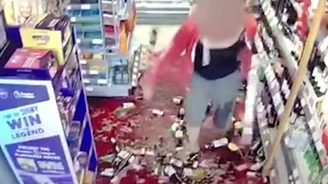 This is the moment the angry shopper smashed dozens of wine bottles in a Co-op store