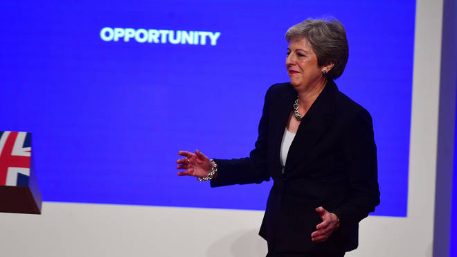 Theresa May dances on to the stage at the Conservative Party Conference