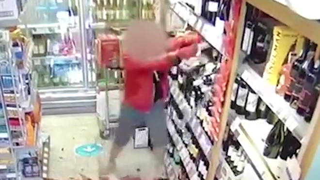 The furious shopper smashed up wine bottles after appearing to shout at staff