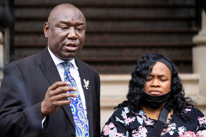 Attorney Ben Crump, left, speaks during a press conference outside City Hall regarding the Breonna Taylor case alongside Tamika Palmer, Breonna Taylor's mother