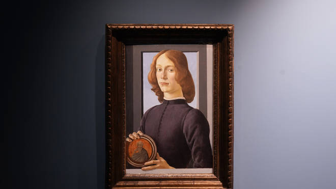 Sandro Botticelli's 15th-century painting, Young Man Holding a Roundel, is displayed at Sotheby's