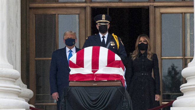Donald Trump and First Lady Melania Trump pictured paying their respects to Supreme Court Justice Ruth Bader Ginsburg