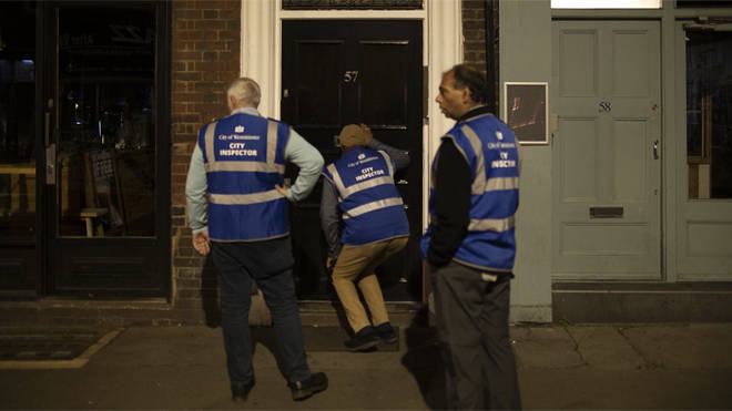 City inspectors look through the letterbox of a cocktail club