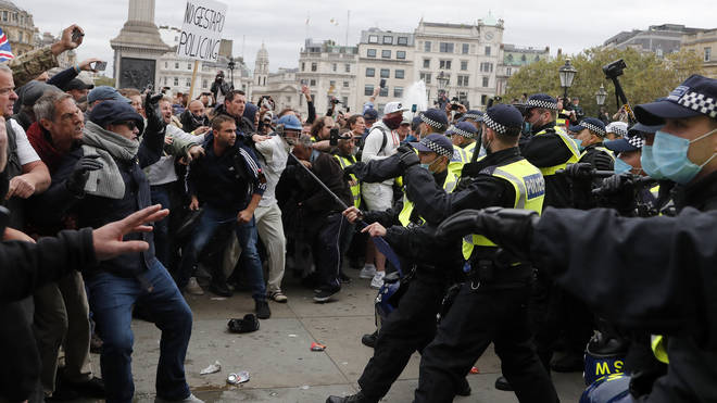 Bottles were thrown as police penned in the crowd