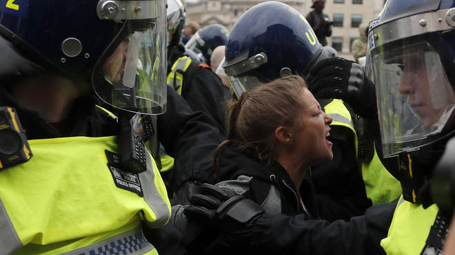 Water was thrown at police, who responded with batons
