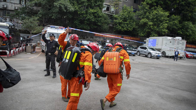 Rescuers arrive at the coal mine in south-west China