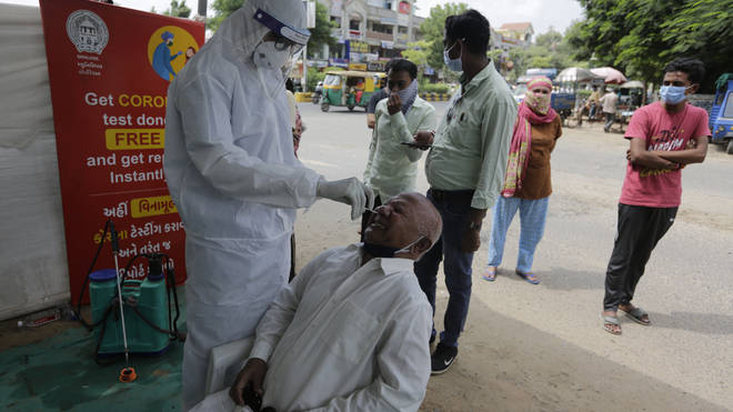 A health worker takes a nasal swab sample to test for Covid-19 in Ahmedabad, India