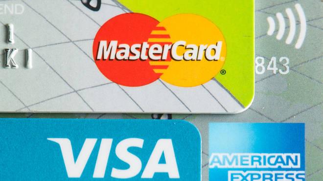 Credit cards showing the logos of American Express, Mastercard and Visa