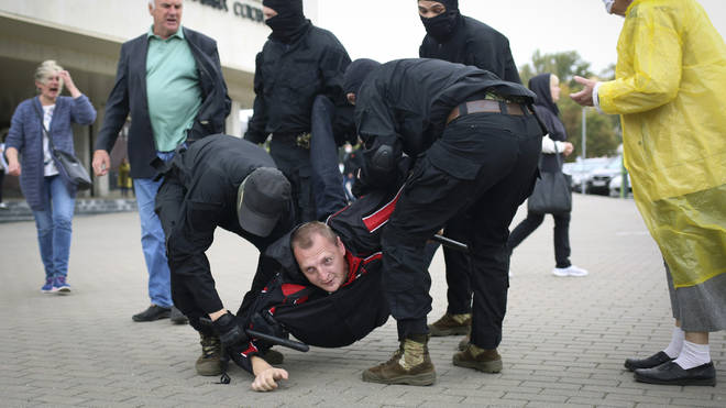 Police detain a man during an anti-government rally