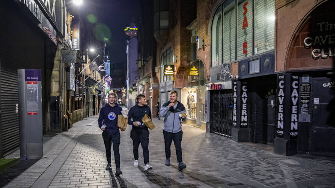 Three men walk past the famous Cavern Club in Liverpool city centre (Peter Byrne/PA)