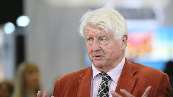 Stanley Johnson has apologised after being snapped not wearing a face covering while shopping