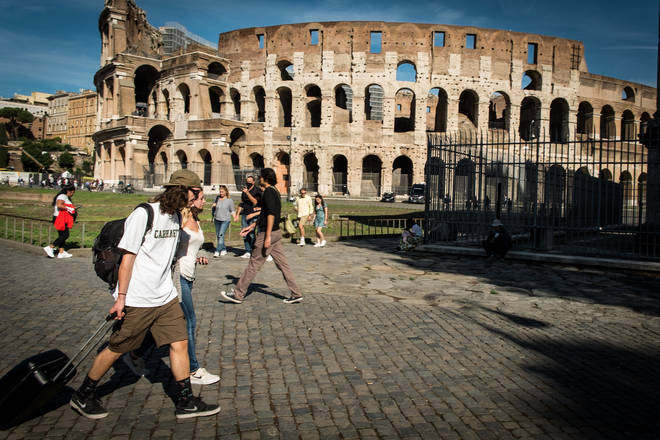 File photo: Tourists walk near the Colosseum in Rome